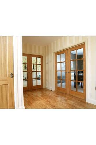 Internal Door Oak 11-8VN 8 Light Clear Bevelled Glass with Raised Mouldings Untreated